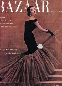 Dorian Leigh wearing a Balenciaga evening dress on the cover of Harper's Bazaar, November 1952. Photo by Richard Avedon.