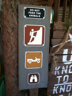 Sign for Journey Off the Map, rock climbing, jeep, binoculars.
