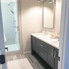 Charcoal Gray Dual vanity with Barbara Cosgrove Library Three Light Shiny Nickel Wall Sconce