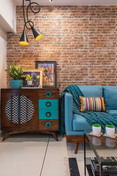 A 800 sq ft small apartment in vibrant blue with 2 bedrooms. The living room is decorated with a brick wall on one side and coordinated furniture all over. Blue and gray living room. Small Room Interior, Small Apartment Interior, Living Room Interior, Living Room Decor, Small Home Interior Design, Indian Home Interior, Indian Home Decor, Indian Wall Decor, Indian Interiors