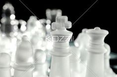 crystal chess king and queen. - Close-up cropped image of white crystal chess king and queen.
