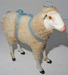 19S CENTURY TOY FIGURING A SHEEP MADE OF PAPIER MACHE & TEXILE