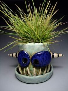 James DeRosso's clay monster flower pot.