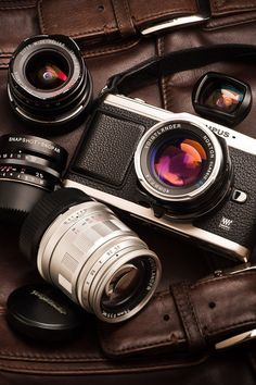 Olympus. This was my first baby with lenses....loved it..still have it