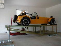 Parking lift adapters for 2 post lift? The Garage