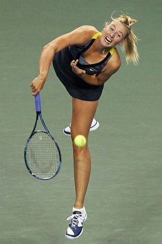 Maria Sharapova of Russia serves in her match against Petra Kvitova of the Czech Republic during the day five of the Toray Pan Pacific Open at Ariake Colosseum on September 29, 2011 in Tokyo, Japan.