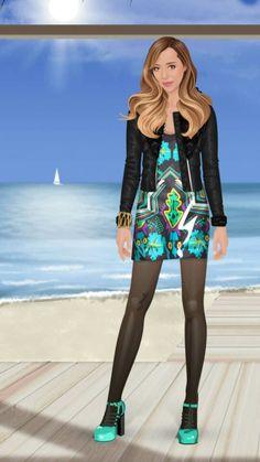 Black jacket with fluffed rest neck Designed print dress Golden bracelet Black tights Light blue high heels