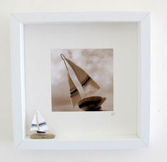 """Box set with driftwood dinghy and art sculpture photo"" by Kathy Harris. Limited edition wood sculpture, Subject: Landscapes, sea and sky, Naive style, From a limited edition of 50, Signed and numbered on the front, This artwork is sold framed, Size: 25 x 25 x 25 cm (framed), 9.84 x 9.84 x 9.84 in (framed), Materials: box frame, photo, driftwood"