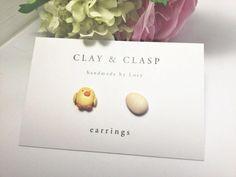 He encontrado este interesante anuncio de Etsy en https://www.etsy.com/es/listing/127080266/easter-earrings-chick-and-egg-earring