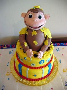 "Curious George is every kid's favorite monkey!  I made George ""pop"" out of this cake."
