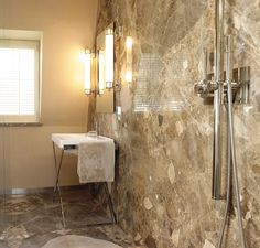 Another view: Wetroom in Italian Breccia Paradiso vein-matched marble. #marble #veinmatched #madeinitaly #www.montpellier.co.uk