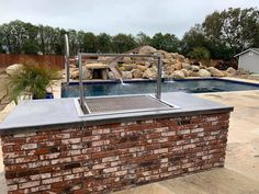 Stainless Santa Maria Countertop Drop In Frame with Height Adjustable Rotisserie by JD Fabrications Wood Charcoal, Charcoal Grill, Santa Maria Grill, Homemade Grill, Western Bathrooms, Outdoor Kitchen Design, Ratchet, Countertops, Dodgers
