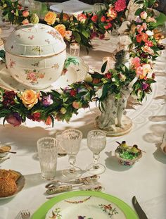 Centerpiece; floral garlands, held up by porcelain figures & surrounding a gorgeous tureen. So pretty.