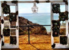 vintage door wedding arbor with succulents and Chandelier