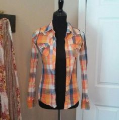 The Buckle plaid shirt Blue and orange plaid shirt from the buckle. Has a weathered look as seen in the last picture. Buckle Tops Button Down Shirts