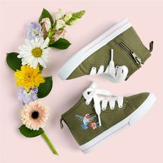 Equipped with a padded insole and cute embroidered detail, these high top sneakers are perfect for school or play.