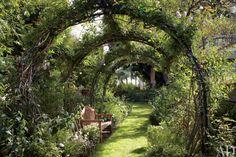 rose covered garden trellis, vine covered garden trellis, trellis archway