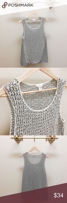 White and Black Chico's Knitted Sleeveless Top Chico's White and Black Knitted Sleeveless Top in EUC. Size 2 Chico's Tops