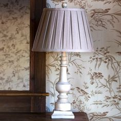 Our Painted Turned Spindle Lamp is a sassy little lamp with a fabric shade and neutral coloring. Visit Antique Farmhouse for more table lamps and lanterns! Farmhouse Table Lamps, Farmhouse Lighting, Tall Lamps, Painting Lamps, Lamp Makeover, Bedroom Lamps, Bedroom Ideas, Unique Lamps, Fabric Shades