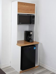 All in one space saver! It's modern, stunning and versatile, can serve as a refreshment station, microwave stand, kitchen cabinet and wine stand cabinet. Microwave Stand, Microwave Cabinet, Microwave Storage, Fridge Storage, Tall Cabinet Storage, Mini Fridge Stand, Mini Fridge In Bedroom, Office Kitchenette, Dorm Fridge