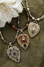 Gemstone Heart Necklace - Breathtaking in its extravagant beauty, this gemstone heart necklace is an eye-catching work of art.