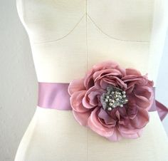 Floral bliss adorns a ribbon belt or hair ribbon. $86 from venust on etsy.com.