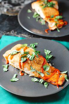 Simple Sriracha Salmon  Ingredients: 1 pound salmon 1 tbsp. honey 1 tbsp. sriracha juice half a lemon garlic salt pepper optional, basil for topping