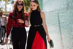 Left, a red and black graphic sweater is paired with high-waisted pants, a Chanel bag, and black sunglasses. Right, a high-neck black dress with red pleats is worn with a skinny belt and top handle bag