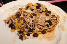Crockpot Chicken Tacos: chicken + corn + black beans + Rotel + taco seasoning. Easy, healthy dinner!