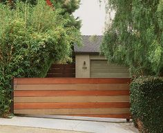 Distinctly modern and graphic driveway gate in the Pacific Palisades neighborhood in Los Angeles, California (US). Designed by California landscape architect, Rob Steiner.