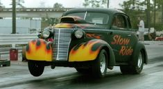 This #WheelsUpWednesday our #CoolCarFind is a flamed 1938 #Chevy Coupe | RacingJunk.com