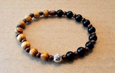 Men's Black Ceramic & Burly Wood Cross Stretch Bracelet by SoFineDesigns on…