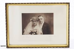 Endearing 1930s framed photo of a wedding-couple dressed in a