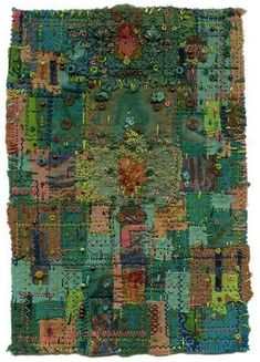Fabric art, buttons, stitches and fabric pieces.