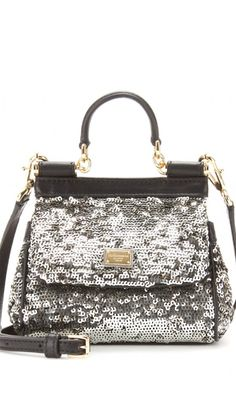 Sac argent à paillettes by Dolce & Gabbana. - Sequined money bag by Dolce & Gabbana.