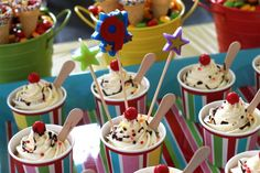 The cupcakes were baked in regular cupcake liners and then placed into ice-cream cups. They were iced, topped with sprinkles, chocolate sauce and a gumball cherry.  An ice-cream spoon was inserted for an added effect.