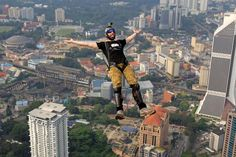 BASE jumper Luke Denniss of Australia - AP Photo: Lai Seng Sin