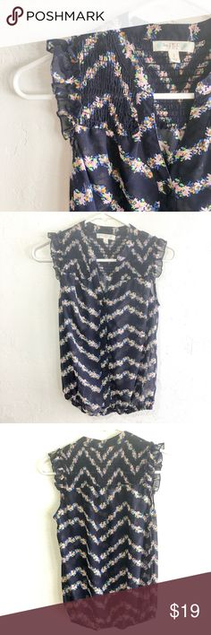 Love Fire floral print top Semi-sheer chiffon chevron stripe button up sleeveless top with gathered elastic hem and ruffles at shoulder. Navy blue and pink floral. Cute for spring! Love Fire Tops Blouses