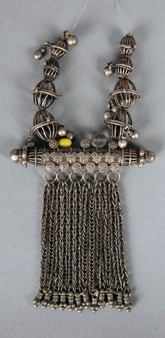 Yemen | Amulet case pendant and beads; metal or low grade silver alloy // ©British Museum. As1978,04.3.b