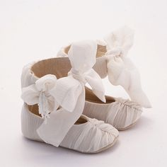 eeeek, these shoes are amazing!!!! White baby shoes from shirred silkchiffon covered leather by Vibys. $55.00, via Etsy.