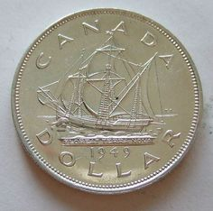 The coin's reverse design was sculpted by Emanuel Hahn and portrays a voyageur and an aboriginal paddling a birch-bark canoe. This silver dollar contains of an ounce of silver. Gold And Silver Coins, Silver Bars, Buy Gold Online, Canadian Coins, Foreign Coins, Coin Display, Coin Worth, Bullion Coins, Mint Coins