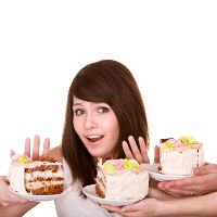 HOW TO STAY PALEO WHEN YOU'RE TIRED AND STRESSED    Woman refusing cake