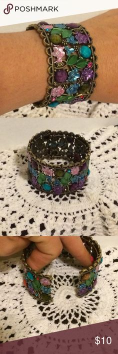 Vintage cuff bracelet Very beautiful cuff bracelet. Floral design with different color gems all around the bracelet. Pre-loved but awesome condition. Jewelry Bracelets