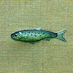 I would love to learn to embroider this little fish and put it on some clothes, like sleeve cuffs, pockets, and the like.