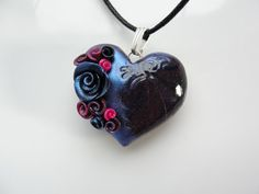 Black heart pendant with black, blue and pink roses on black cotton cord necklace. $18.00, via Etsy.