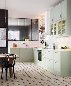 Lovely kitchen in combination with copper, light green and black. Open Plan Kitchen, Kitchen Dining, Kitchen Decor, Green Kitchen, Küchen Design, House Design, Kitchen Stories, Interiores Design, Kitchen Interior