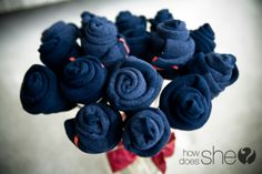 How to Make a Sock Bouquet - You could use this for a guy who wants socks, or you could make a more colourful one for a little girl who's getting a practical item for a gift- or you could use it for a baby shower (so many fun reasons to roll socks!