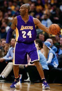 Kobe Bryant Wearing a Purple/White-Yellow Nike Kobe 11 PE (1)