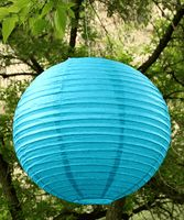 """round paper lanterns in sizes from 12"""" to 20"""", and several colors."""