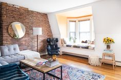 Living room in a Boston apartment with exposed brick